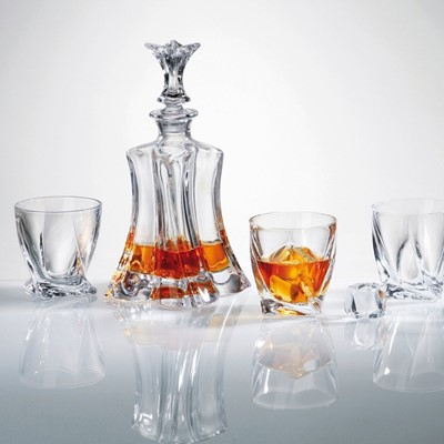 Bohemia decanter is a stunning combination of brilliance and clarity. Improve the taste and aesthetics of fine wine, cordial, brandy or spirits by decanting them into Bohemia decanters. This gorgeous decanter will perfectly compliment your table This whisky/whiskey decanter capacity is 700ml Height 27cm Width 13cm Each Glass Capacity 340 ml Each Glass Height 9.5 cm Each glass Width 9.5 Luxury product Novel and superb glassware gift idea as it comes in a gift box and are dishwasher safe however hand wash recommended to preserve shine and brilliance Part of Bohemia Crystalite collection