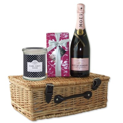 Give a Hamper for Mothers Day which consists of a 70cl bottle of Moet Rose along with a beautiful scented candle and a luxury selection of Fine Belgian Chocolates all beautifully presented in a wicker hamper basket.