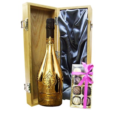 A single bottle of Armand de Brignac Gold Champagne & Box of fine Hand Finished English Chocolates 100g Presented in a luxury wooden gift box luxurious light Oak wooden box with hinged lid and clasp. The box is lined with Silver silk and comes with a Gift Card for your personal message. Price includes free UK Mainland Delivery, and Exports and international delivery available.