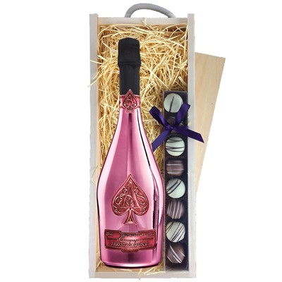 A single bottle ofArmand de Brignac rose Champagne & a single strip of fine Hand Made Truffles 100g Presented in a wooden gift box with sliding lid and lined with wood wool with a Gift Card for your personal message. Price includes free UK Mainland Delivery, and Exports and international delivery available.