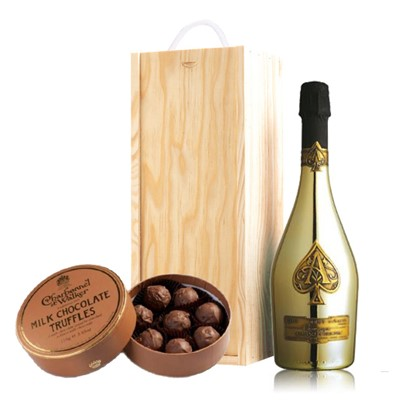 A single bottle of Armand de Brignac Gold 75cl, Champagne & Charbonnel  Milk Chocolate Truffles (110g), Presented in a wooden gift box with sliding lid and lined with wood wool with a Gift Card for your personal message. . Price includes free UK Mainland Delivery, and Exports and international delivery available.