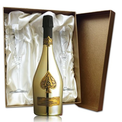 Armand de Brignac Gold In Gold Presentation Set with Flutes  75cl bottle of Armand de Brignac Gold, Champagne and two beautiful hand cut lead crystal champagne flutes (260mm)all supplied in a Luxury Presentation box. Available for mainland UK delivery only.  . Price includes free UK Mainland Delivery, and Exports and international delivery available.