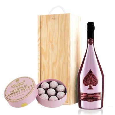 A single bottle of Armand de Brignac Rose 75cl, Champagne & Charbonnel  Pink Marc de Champagne Truffles (135g), Presented in a wooden gift box with sliding lid and lined with wood wool with a Gift Card for your personal message. . Price includes free UK Mainland Delivery, and Exports and international delivery available.