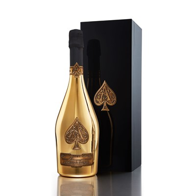 Buy Send a single bottle of Armand de Brignacs unmistakable gold plated bottle has its roots in the French fashion industry and its reputation for opulence. Originally conceived by the celebrated Andre Courreges fashion house the striking bottle is decorated at a single site in Frances Cognac region and is fitted with four pewter labels that are hand applied to the surface of the bottle.Armand de Brignac is a Prestige Cuvee produced in the traditional old world style from grape to glass. The Brut Gold also known as 'ACE OF SPADES' is pressed from a perfectly balanced blend containing Chardonnay Pinot Noir and Pinot Meunier wine. On the palate Armand de Brignac has a sumptous racy fruit character that is perfectly integrated with the wines subtle brioche accents. The Champagnes texture is deliciously creamy with great depth paired with a long silky finish. . Price includes free UK Mainland Delivery, and Exports and international delivery available.