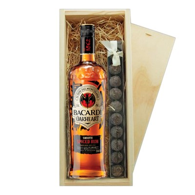 Bacardi Oakheart & Truffles Wooden Box   A single bottle of Bacardi Oakheart Smooth & Spiced Drak Rum 70cl & a single strip of fine Hand Made Truffles 100g Presented in a wooden gift box with sliding lid and lined with wood wool with a Gift Card for your personal message.  . Price includes free UK Mainland Delivery, and Exports and international delivery available.