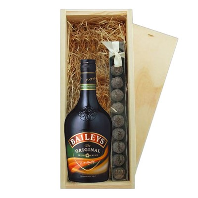 Baileys Irish Cream 70cl & Truffles Wooden Box   A single bottle of Baileys Irish Cream 70cl & a single strip of fine Hand Made Truffles 100g Presented in a wooden gift box with sliding lid and lined with wood wool with a Gift Card for your personal message.  . Price includes free UK Mainland Delivery, and Exports and international delivery available.