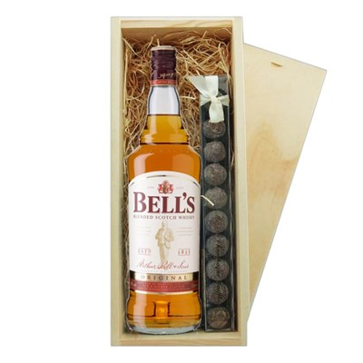 Bell's Whisky & Truffles Wooden Box   A single bottle of Bell's Blended Scotch Whisky & a single strip of fine Hand Made Truffles 100g Presented in a wooden gift box with sliding lid and lined with wood wool with a Gift Card for your personal message.  . Price includes free UK Mainland Delivery, and Exports and international delivery available.