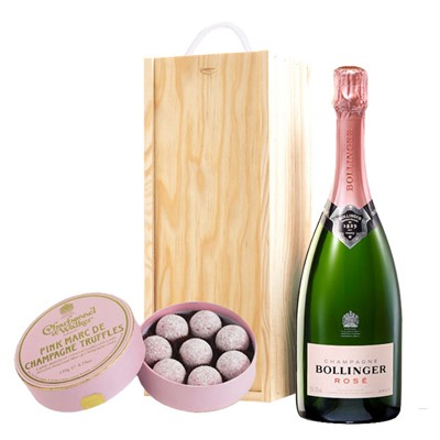 A single bottle of Bollinger Brut 75cl, Champagne & Charbonnel Pink Marc de Champagne Truffles (135g), Presented in a wooden gift box with sliding lid and lined with wood wool with a Gift Card for your personal message. Price includes free UK Mainland Delivery, and Exports and international delivery available.