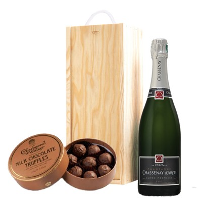 A single bottle of Chassenay d'Arce Cuvee Premiere Brut 75cl, Champagne & Charbonnel  Milk Chocolate Truffles (110g), Presented in a wooden gift box with sliding lid and lined with wood wool with a Gift Card for your personal message. . Price includes free UK Mainland Delivery, and Exports and international delivery available.
