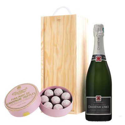 A single bottle of Chassenay d'Arce Cuvee Premiere Brut 75cl, Champagne & Charbonnel  Pink Marc de Champagne Truffles (135g), Presented in a wooden gift box with sliding lid and lined with wood wool with a Gift Card for your personal message. Charbonnel's Pink Truffls are world renowned with a milk chocolate, butter and Marc de Champagne centre, finished with a light dusting of icing sugar. . Price includes free UK Mainland Delivery, and Exports and international delivery available.
