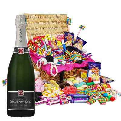 Chassenay d'Arce Brut and Classic Retro Sweet Hamper  Our classic original retro sweet hamper is packed with all of your childhood memories and makes the perfect gift or selfish sweetie treat for you! Quite how we managed to pack 27 different retro sweet varieties in here, we will never know but as lovers of the retro sweet, we know it was worth it to bring so much joy to your sweet tooth. The sweets are presented in a beautiful hamper measuring 320x220x120mm and come complete with a personalised card for that final personal touch. This Hamper comes with a Full bottle (75cl) of Chassenay d'Arce Cuvee Premiere Brut.  . Price includes free UK Mainland Delivery, and Exports and international delivery available.