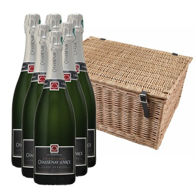 Buy a case of six Chassenay d'Arce Cuvee Premiere Brut none vintage Champagne, 75cl All packed up in with shredfill in a traditional wicker hamper basket. Handwoven and made from top quality Autumn willow. Our wicker is steamed first to avoid splitting when weaving and then boiled afterwards to darken its colour. Faux leather hinges and straps with cut out handles on either end, finish off the product beautifully  . Price includes free UK Mainland Delivery, and Exports and international delivery available.