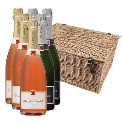 Buy a case of 3 Chassenay d'Arce Cuvee Premiere Brut NV and 3 Chassenay d'Arce Rose NV Champagne, 75cl All packed up in with shredfill in a traditional wicker hamper basket. Handwoven and made from top quality Autumn willow. Our wicker is steamed first to avoid splitting when weaving and then boiled afterwards to darken its colour. Faux leather hinges and straps with cut out handles on either end, finish off the product beautifully. Wicker hampers, with their obvious on going use around the home, are rarely thrown away and in fact are perfect gifts in their own right. No nasty stains or varnish are used in the manufacturing process. . Price includes free UK Mainland Delivery, and Exports and international delivery available.