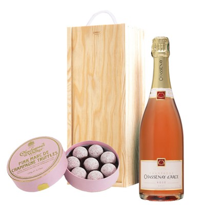 A single bottle of Chassenay d'Arce Rose 75cl, Champagne & Charbonnel  Pink Marc de Champagne Truffles (135g), Presented in a wooden gift box with sliding lid and lined with wood wool with a Gift Card for your personal message. . Price includes free UK Mainland Delivery, and Exports and international delivery available.