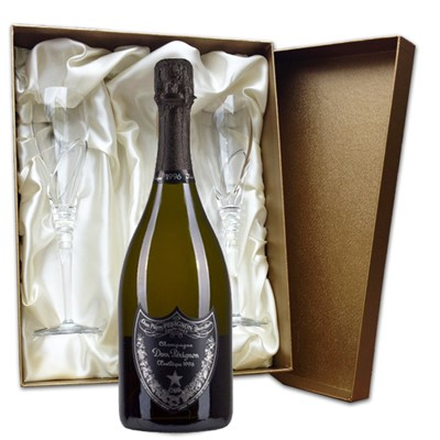 Dom Perignon Plenitude P2 in Gold Presentation Set with Flutes  75cl bottle of Dom Perignon Plenitude P2 Champagne and two beautiful hand cut lead crystal champagne flutes (260mm)all supplied in a Luxury Presentation box.  . Price includes free UK Mainland Delivery, and Exports and international delivery available.