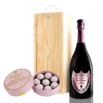 A single bottle of Dom Perignon Rose 75cl, Champagne & Charbonnel  Pink Marc de Champagne Truffles (135g), Presented in a wooden gift box with sliding lid and lined with wood wool with a Gift Card for your personal message. . Price includes free UK Mainland Delivery, and Exports and international delivery available.