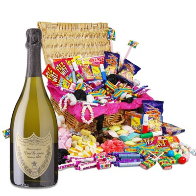 Dom Perignon and Classic Retro Sweet Hamper  Our classic original retro sweet hamper is packed with all of your childhood memories and makes the perfect gift or selfish sweetie treat for you! Quite how we managed to pack 27 different retro sweet varieties in here, we will never know but as lovers of the retro sweet, we know it was worth it to bring so much joy to your sweet tooth. The sweets are presented in a beautiful hamper measuring 320x220x120mm and come complete with a personalised card for that final personal touch. This Hamper comes with a Full bottle (75cl) of Dom Perignon Brut.  . Price includes free UK Mainland Delivery, and Exports and international delivery available.