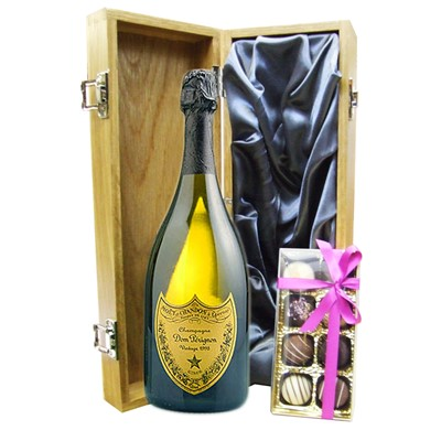 A single bottle of Dom Perignon Champagne & Box of fine Hand Finished English Chocolates 100g Presented in a luxury wooden gift box luxurious light Oak wooden box with hinged lid and clasp. The box is lined with Silver silk and comes with a Gift Card for your personal message. Price includes free UK Mainland Delivery, and Exports and international delivery available.