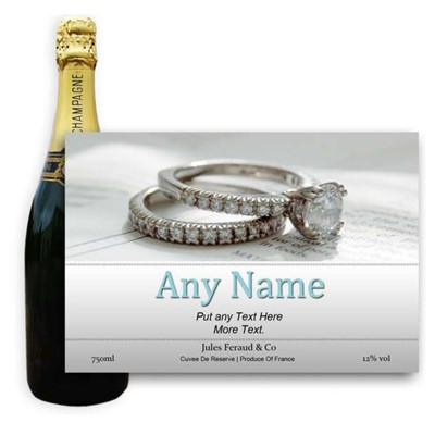 Engagement Ring Label-Buy a bottle of Champagne Jules Feraud Brut Cuvee NV 75cl personalised as a gift that is a perfect for celebrating with style! Create your very own Personalised Bottle of Champagne with your own message on the bottle which is printed in full colour. Jules Feraud is a rich Champagne with savoury aromas. This deep golden Champagne is powerful but elegant; strong bodied and dry yet still balanced. A fresh fun and lively champange for any occasion..and deliciously easy to drink! Please Keep the Message to Maximum of 25 words Gift Message will be used as message on the label . Price includes free UK Mainland Delivery, and Exports and international delivery available.