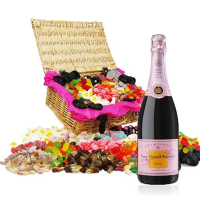 Retro Jellies Hamper and Veuve Rose Champagne If you love Retro Jelly sweets as much as we do this stunning hamper will make you go all wobbly and probably fall over. We have crammed a whopping 16 varieties of Jelly Sweet inside for your sweetie happiness including Cola Bottles Fried Eggs Jelly Snakes and Giant Fizzy Strawberries. This Hamper comes with a Full bottle 75cl of Veuve Clicquot Rose Champagne . Price includes free UK Mainland Delivery, and Exports and international delivery available.