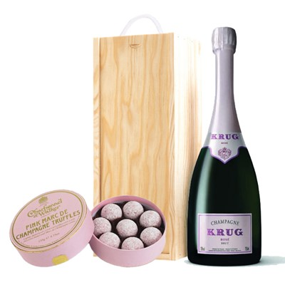 A single bottle of Krug Rose 75cl, Champagne & Charbonnel  Pink Marc de Champagne Truffles (135g), Presented in a wooden gift box with sliding lid and lined with wood wool with a Gift Card for your personal message. . Price includes free UK Mainland Delivery, and Exports and international delivery available.