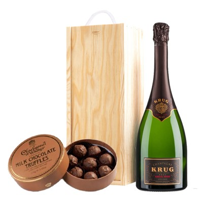 A single bottle of Krug Grande Vintage 2004 75cl, Champagne & Charbonnel  Milk Chocolate Truffles (110g), Presented in a wooden gift box with sliding lid and lined with wood wool with a Gift Card for your personal message. . Price includes free UK Mainland Delivery, and Exports and international delivery available.