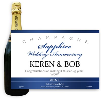 Personalised Champagne - Sapphire Anniversary Label - A bottle of Champagne, Jules Feraud, Brut Cuvee personalised as a gift that is a perfect for celebrating with style! Create your very own Personalised Bottle of Champagne with your own message on the bottle, which is printed in full colour. Jules Feraud is a rich Champagne with savoury aromas. This deep, golden Champagne is powerful but elegant; strong bodied and dry yet still balanced. A fresh, fun and lively champagne for any occasion...and deliciously easy to drink! (Please Keep the Message to Maximum of 25 words, Gift Message will be used as message on the label)