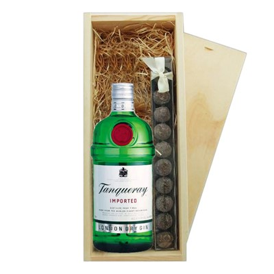 Tanqueray Dry Gin And Truffles Wooden Box   A single bottle of Tanqueray Dry Gin And a single strip of fine Hand Made Truffles 100g Presented in a wooden gift box with sliding lid and lined with wood wool with a Gift Card for your personal message.  . Price includes free UK Mainland Delivery, and Exports and international delivery available.