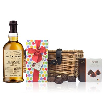 Balvenie 12 Year Old DoubleWood and Chocolates Hamper A delightful gift of Balvenie 12 Year Old DoubleWood Speyside Single Malt Scotch Whisky along with a box of Mini Duc d'O Belgin Chocolates 50g and Belgid'Or Fine Belgin Chocolates 175g all packed in a wicker hamper with leather straps lined with wood wool.  All gifts come with a gift card with message of your choice.  . Price includes free UK Mainland Delivery, and Exports and international delivery available.