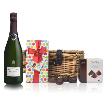 A delightful gift of Bollinger Grande Annee Rose 2005 along with a box of Mini Duc d'O Belgin Chocolates (50g) and Belgid'Or Fine Belgin Choclates (175g) all packed in a wicker hamper with leather straps, lined with wood wool. Price includes free UK Mainland Delivery, and Exports and international delivery available.