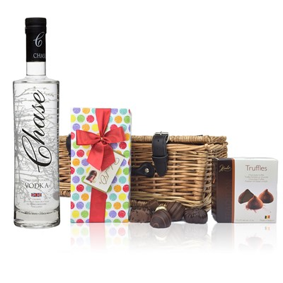 Chase Vodka  English Vodka and Chocolates Hamper A delightful gift of Chase Vodka  English Vodka along with a box of Mini Duc d'O Belgin Chocolates 50g and Belgid'Or Fine Belgin Choclates 175g all packed in a wicker hamper with leather straps lined with wood wool. All gifts come with a gift card with message of your choice. . Price includes free UK Mainland Delivery, and Exports and international delivery available.