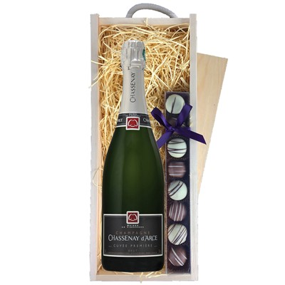 A single bottle of Chassenay d'Arce Brut Champagne & a single strip of fine Hand Made Truffles 100g Presented in a wooden gift box with sliding lid and lined with wood wool with a Gift Card for your personal message. Price includes free UK Mainland Delivery, and Exports and international delivery available.