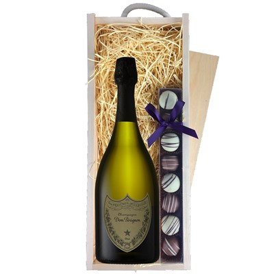 A single bottle of Dom Perignon Champagne & a single strip of fine Hand Made Truffles 100g Presented in a wooden gift box with sliding lid and lined with wood wool with a Gift Card for your personal message. Price includes free UK Mainland Delivery, and Exports and international delivery available.