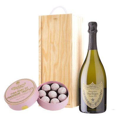 A single bottle of Dom Perignon Brut 75cl, Champagne & Charbonnel  Pink Marc de Champagne Truffles (135g), Presented in a wooden gift box with sliding lid and lined with wood wool with a Gift Card for your personal message. Charbonnel's Pink Truffls are world renowned with a milk chocolate, butter and Marc de Champagne centre, finished with a light dusting of icing sugar. . Price includes free UK Mainland Delivery, and Exports and international delivery available.