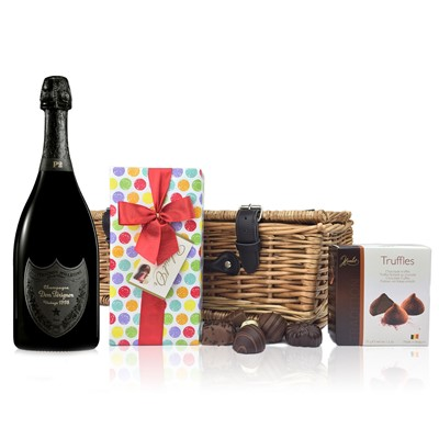 A delightful gift of Dom Perignon Plenitude P2 75cl along with a box of Mini Duc d'O Belgin Chocolates (50g) and Belgid'Or Fine Belgin Choclates (175g) all packed in a wicker hamper with leather straps, lined with wood wool.  . Price includes free UK Mainland Delivery, and Exports and international delivery available.