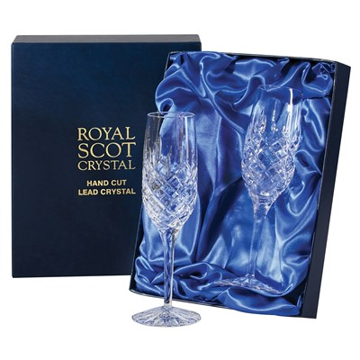 2 Royal Scot Champagne Flutes - London - PRESENTATION BOXED - A pair of beautiful hand cut lead crystal Royal Scot Champagne Flutes, London design in a high quality blue leatherette box with blue satin linings.