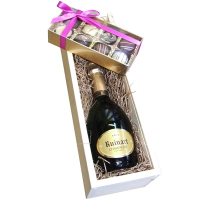 Half Bottle Ruinart Brut 37.5cl with Truffles 100g Presented in a Wooden Box Lined with wood wool comes with a Gift Card for your personal message. . Price includes free UK Mainland Delivery, and Exports and international delivery available.