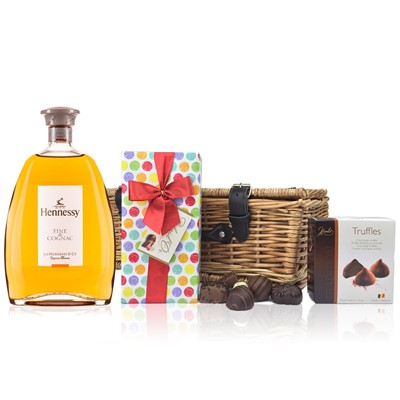 Hennessy Fine De Cognac and Chocolates Hamper A delightful gift of Hennessy Fine De Cognac Wine along with a box of Mini Duc d'O Belgin Chocolates 50g and Belgid'Or Fine Belgin Choclates 175g all packed in a wicker hamper with leather straps lined with wood wool. All gifts come with a gift card with message of your choice.  . Price includes free UK Mainland Delivery, and Exports and international delivery available.