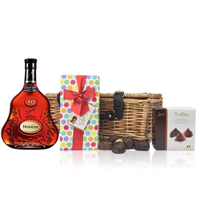Hennessy 70cl X.O. Cognac and Chocolates Hamper A delightful gift of Hennessy 70cl X.O. along with a box of Mini Duc d'O Belgin Chocolates 50g and Belgid'Or Fine Belgin Choclates 175gall packed in a wicker hamper with leather straps lined with wood wool.  All gifts come with a gift card with message of your choice.  . Price includes free UK Mainland Delivery, and Exports and international delivery available.