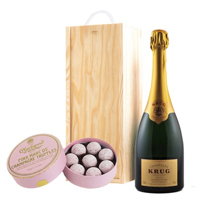 A single bottle of Krug Grande Cuvee 75cl, Champagne & Charbonnel  Pink Marc de Champagne Truffles (135g), Presented in a wooden gift box with sliding lid and lined with wood wool with a Gift Card for your personal message. . Price includes free UK Mainland Delivery, and Exports and international delivery available.