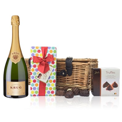 A delightful gift of Krug along with a box of Mini Duc d'O Belgin Chocolates 50g and Belgid'Or Fine Belgin Choclates 175g all packed in a wicker hamper with leather straps lined with wood wool. Price includes free UK Mainland Delivery, and Exports and international delivery available.