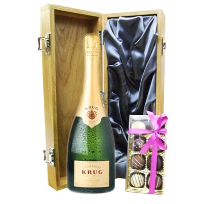 A single bottle of Krug Grande Cuvee Champagne & Box of fine Hand Finished English Chocolates 100g Presented in a luxury wooden gift box luxurious light Oak wooden box with hinged lid and clasp. The box is lined with Silver silk and comes with a Gift Card for your personal message. Price includes free UK Mainland Delivery, and Exports and international delivery available.
