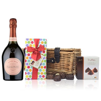A delightful gift of Laurent Perrier Rose along with a box of Mini Duc d'O Belgin Chocolates 50g and Belgid'Or Fine Belgin Choclates 175g all packed in a wicker hamper with leather straps lined with wood wool. Price includes free UK Mainland Delivery, and Exports and international delivery available.