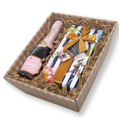 Mini Lanson Rose champagne and Chocolates in a Tray A beautiful hand packed mini Lanson Rose along with a wrapped box of chocolates. Have an evening of pure indulgence or buy and send as a gift.