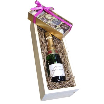 Mini Laurent Perrier La Cuvee 20cl with Truffles 100g Presented in a Wooden Box Lined with wood wool comes with a Gift Card for your personal message. . Price includes free UK Mainland Delivery, and Exports and international delivery available.