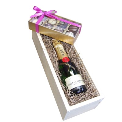 Mini Moet and Chandon Brut 20cl with Truffles 100g Presented in a Wooden Box Lined with wood wool comes with a Gift Card for your personal message. . Price includes free UK Mainland Delivery, and Exports and international delivery available.