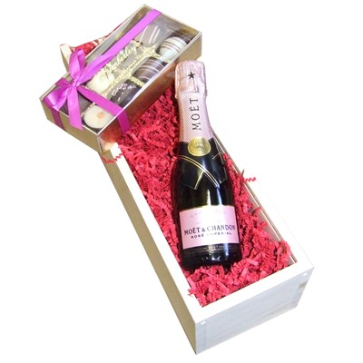 Mini Moet and Chandon Rose 20cl with Truffles 100g Presented in a Wooden Box Lined with wood wool comes with a Gift Card for your personal message. . Price includes free UK Mainland Delivery, and Exports and international delivery available.