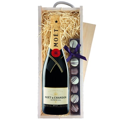 A single bottle of Moet & Chandon Brut Imperial , Champagne & a single strip of fine Hand Made Truffles 110g, Presented in a wooden gift box with sliding lid and lined with wood wool with a Gift Card for your personal message. Price includes free UK Mainland Delivery, and Exports and international delivery available.