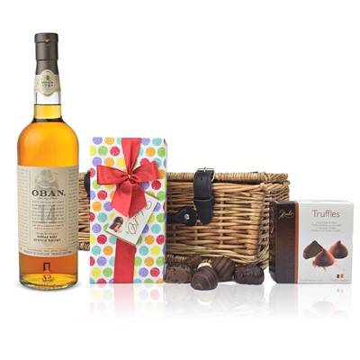 Oban 14 Year Old Whisky and Chocolates Hamper A delightful gift of Oban 14 Year Old Highland Single Malt Scotch Whisky along with a box of Mini Duc d'O Belgin Chocolates 50g and Belgid'Or Fine Belgin Choclates 175g all packed in a wicker hamper with leather straps lined with wood wool. All gifts come with a gift card with message of your choice.  . Price includes free UK Mainland Delivery, and Exports and international delivery available.