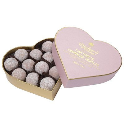 Charbonnel - Pink Marc de Champagne Truffle Heart (200g)- Pink chocolate truffles with a milk chocolate, butter and Marc de Champagne centre, finished with a light dusting of icing sugar. Then carefully packed into a gold-embossed heart shape box.